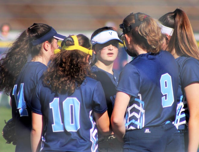 Members of the York High School softball team gather during last Thursday's home opener against Class A Massabesic.
