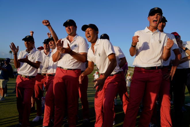 The USA team celebrates its win against the Great Britain and Ireland team in the Walker Cup Sunday at Seminole Golf Club in Juno Beach.