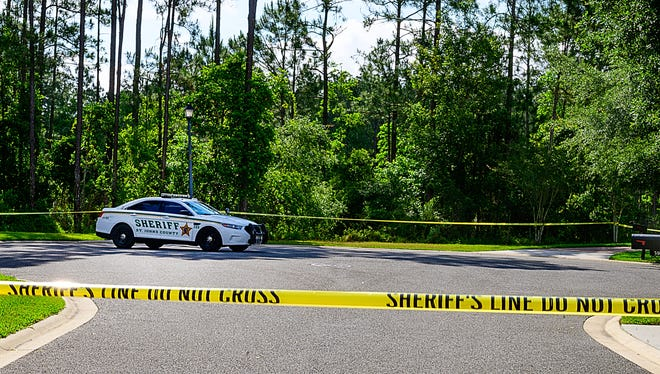 A St. Johns County Sheriff's deputy sits in his car at the end of Saddlestone Drive in the Durbin Creek community on Monday, May 10, 2021, near where the body of Tristyn Bailey, 13, was found on Sunday.