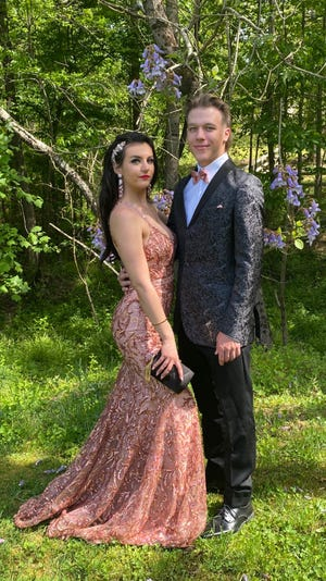 Isabella Killough and her boyfriend Tyler Alewine pose in what would have been their prom outfits.