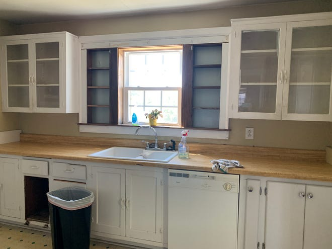 A FLIPPIN' KITCHEN: To update the kitchen of this historic Bristol, Tenn., home (shown before and after), the New Again Houses team repainted upper glass-door cabinets and shelving, and installed new base cabinets, laminate countertops, a tile backsplash and new hardware. They replaced laminate flooring with ceramic tiles, put in a new sink, faucet and light fixture, replaced appliances, added a dishwasher, and painted walls Sherwin Williams Silvermist.