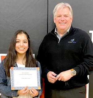 Sturgis High School Senior Brenda Garcia Lopez, winner of the $10,000, receives a scholarship from Matt Betts, president at Level Data. Lopez was among numerous students who received recognition May 7 at the senior honors ceremony.
