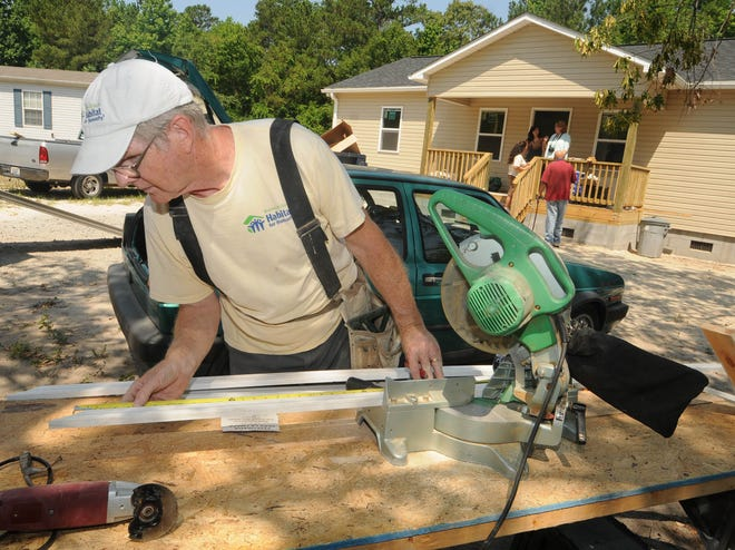 A Brunswick County Habitat for Humanity volunteer helps build a Leland home in 2011. The organization plans to buy a property to replace its Leland Restore location.