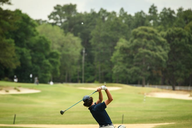 Western Alamance's Jake Clayton tees off on the tenth hole during the 3-A state golf championship at Longleaf Golf & Family Club on Monday, May 10, 2021, in Southern Pines.