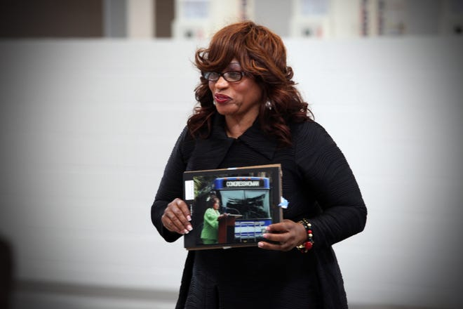 Then-Congresswoman Corrine Brown received a photo of herself with an Regional Transit System bus as a gift from Mayor Ed Braddy during an event held at the Corrine Brown Transit Facility in 2014.