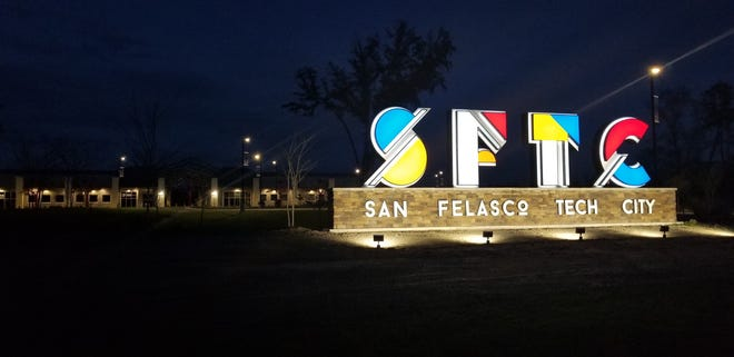 A sign is lit outside San Felasco Tech City in Alachua. The next phase of construction for the multiuse development begins this summer, bringing more office space and a brewery, set to open in 2022. [Courtesy of Mitch Glaeser]