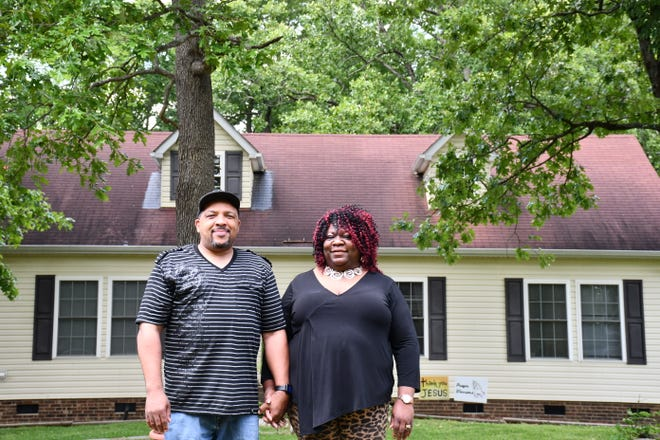 Steven and Ramona Allen outside their new home in Alamance County.