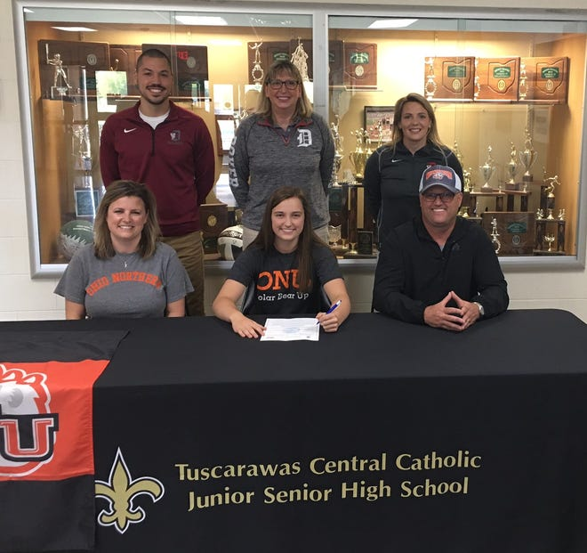 Tuscarawas Central Catholic senior Sydney Selinsky signed a letter of intent to swim for Ohio Northern University. She will be majoring in Pharmacy. Pictured with Sydney are her parents Scott and Jacki Selinsky along with her swimming coaches from Dover Matt Petricola, Brenda Wherley and JoLyn McFadden.