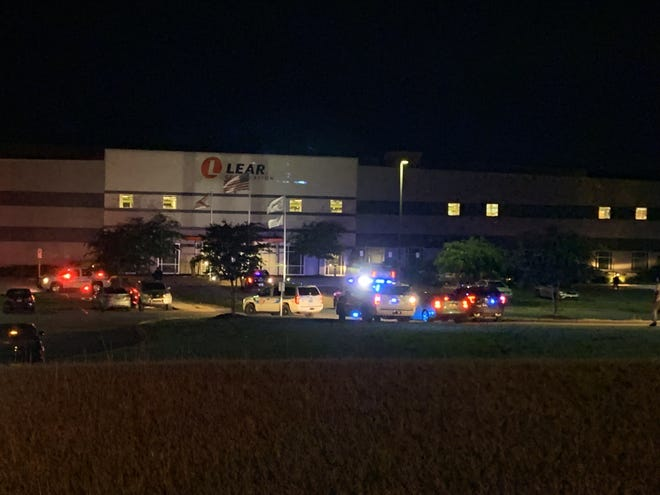 Authorities arrive at the scene of a fatal shooting at Lear Corp. in 2019.