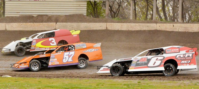 Modified drivers Arne Anderson of Watertown (3), Duke Erickson of Sioux Falls (57) and Dale Ames of Huron (6) battle for position during a heat race Sunday night during the Mother's Day Season Opener at Casino Speedway.
