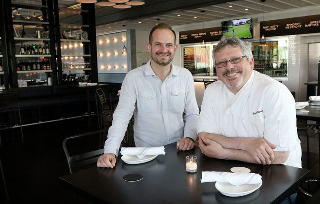 Shore Gregory, left, managing partner, and Jeremy Sewall, chef-owner, posed for a portrait before the doors opened for the soft opening of Row 34, May 7, 2021.