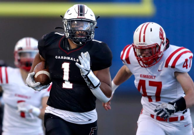 Fond du Lac's Braelon Allen (1) is chased by Kimberly's Mason Stepanski during a touchdown run May 7 at Appleton East High School. Allen was voted the AP alternate season player of the year Thursday.