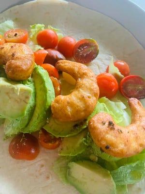 "Plant-based ""shrimp"" on a salad at 2 Guys."