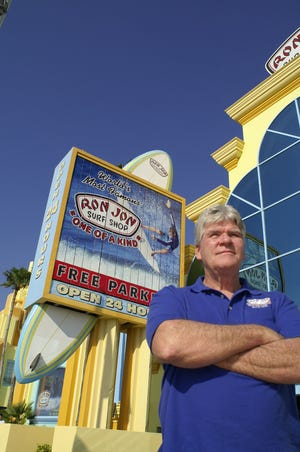 John Griffin stands outside Ron Jon's Surf Shop in Cocoa Beach in 2006. Griffin and friend Dick Catri were original organizers of the Easter Surfing Festival.