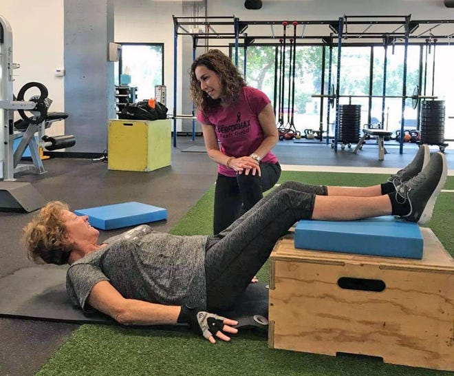 Risa Stewart, owner and trainer of Club Performax in Melbourne, works with a client during a recent workout.