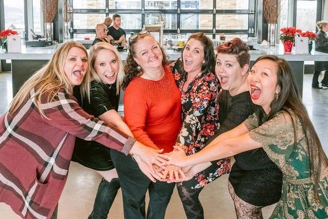 Matrix Cos. employees Cathy Malone, Katie Mahon, Angela Lanzetta, Kari Bullock, Dora Rice and Crystal Sikes at a company event.