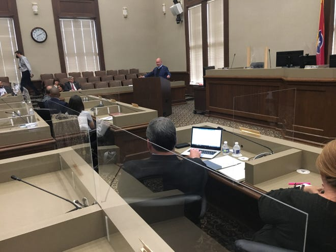 From the podium in Montgomery County Commission chambers, state Comptroller Jason Mumpower addresses representatives of Montgomery, Stewart and Houston counties about their federal stimulus funding.