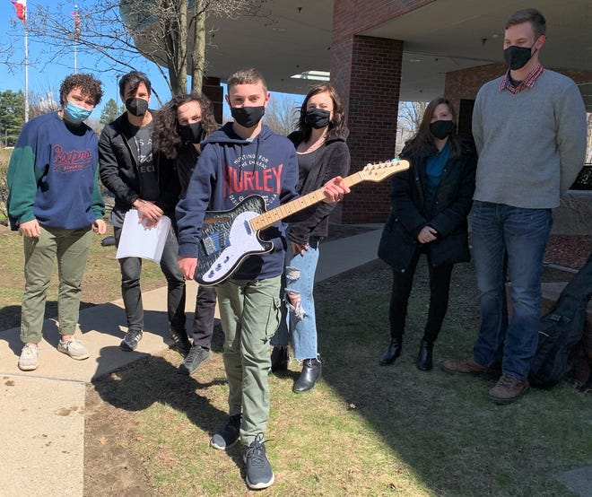 A recipient of a guitar via Choose Joy Productions at Shriner's Hospital for Children in Erie, Pennsylvania, with members of the band First to Eleven. The nonprofit organizations started by Coshocton natives has local musical artists present guitars to children in medical facilities.