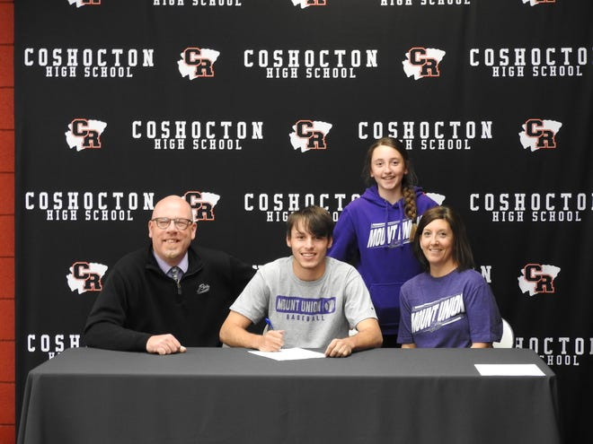 Coshocton senior Nathan Fauver (seated in the center) signed his letter of intent to play baseball for Mount Union on Thursday. His father, Grant and mother, Christi also seated, and sister, Abby, standing, were pictured.