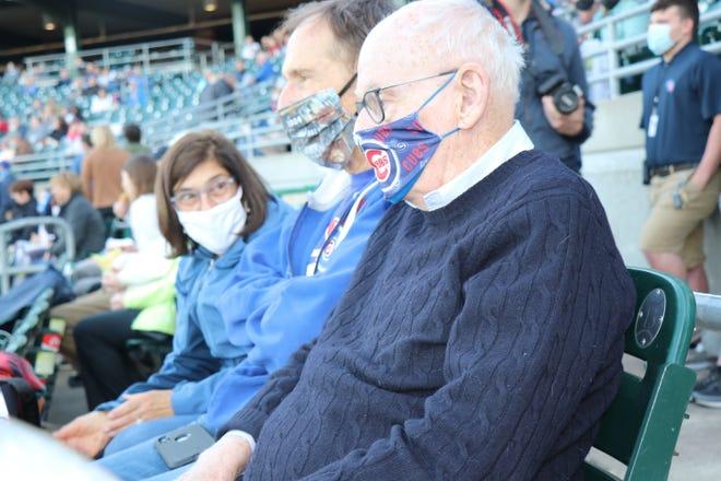 Iowa Cubs majority owner Michael Gartner, right, sits next to U.S. Senior District Judge Robert W. Pratt at Principal Park last week.