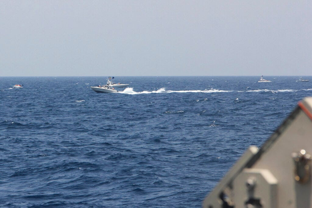 US ship fires warning shots in encounter with Iranian boats 1