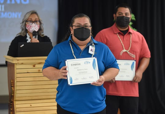 Patricia L.G. Toves holds her certificate of completion for photographers during the Truck Driving Boot Camp ll Completion Ceremony at the Guam Community College Multipurpose Auditorium, Mangilao, May 10, 2021.