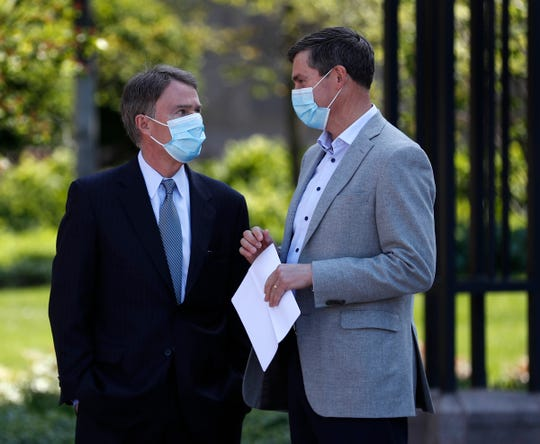 Mayor Joe Hogsett, left, speaks with Eli Lilly and Company CEO David Ricks before a press conference Monday, May 10, 2021 about the back-to-work plan for Lilly, at the downtown Indianapolis headquarters.