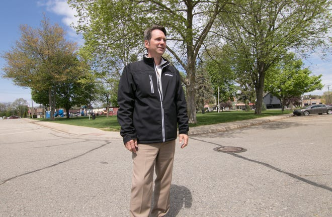 Michael Szafranski, vice president of the Pinckney Putnam Hamburg Hell Chamber of Commerce, stands at the corner of Mill and Livingston streets in the village of Pinckney Monday, May 10, 2021, where food truck events will take place June 6, July 23 and Aug. 20 of this year.