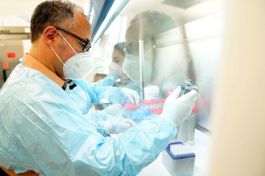 Jose Mediavilla, lab manager, and Kaelea Composto, research technician, test COVID virus samples for variants in a laboratory at the Center for Discovery and Innovation in Nutley on Monday, May 10, 2021.