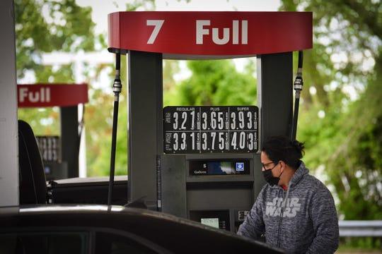 Gas attendant Julio Echeverria pumps gas into a car at Lukoil in Fair Lawn on 05/10/21.