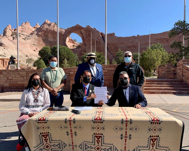 Navajo Nation President Jonathan Nez, front center, signed on May 7 a tribal council resolution to direct the use of the Permanent Trust Fund interest. He was joined by Delegates Otto Tso, Raymond Smith Jr. and Elmer Begay, top row, and first lady Phefelia Nez and Vice President Myron Lizer, bottom row.