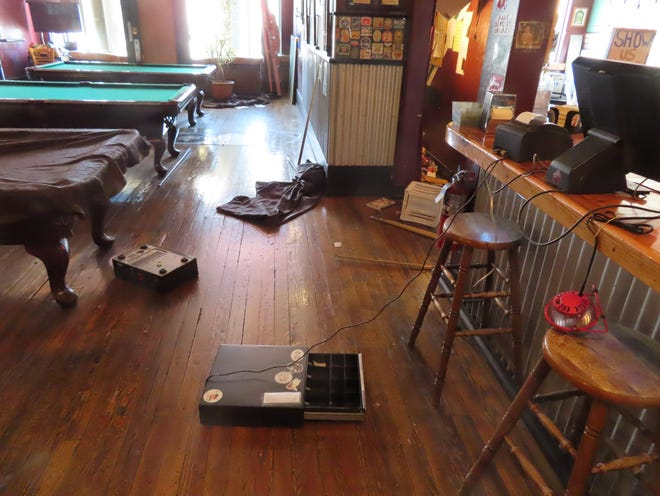 Several objects were thrown to the floor during a burglary early Monday at the Three Rivers Tap & Game Room in downtown Farmington.