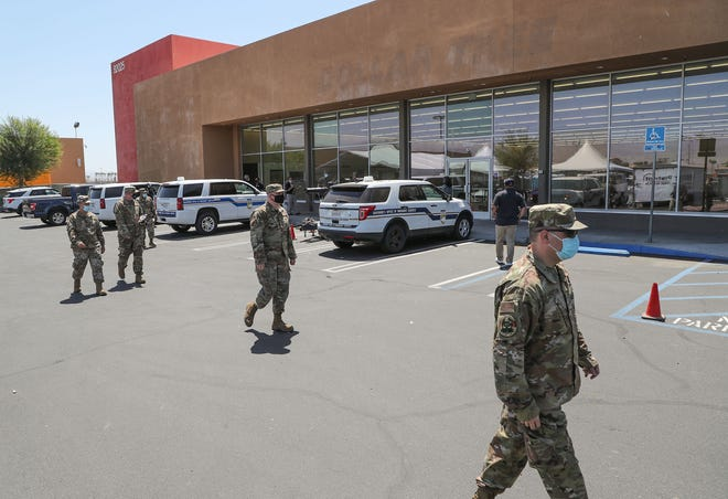 Members of the National Guard COVID-19 Response walk in front of the building at  82025 Hwy 111 in Indio, May 10, 2021.  The building was being converted to a temporary testing site.