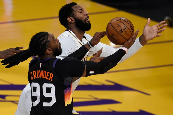 May 9, 2021; Los Angeles, California, USA; Phoenix Suns forward Jae Crowder (99) and Los Angeles Lakers center Andre Drummond (2) battle for the ball during the first half at Staples Center. Mandatory Credit: Kelvin Kuo-USA TODAY Sports