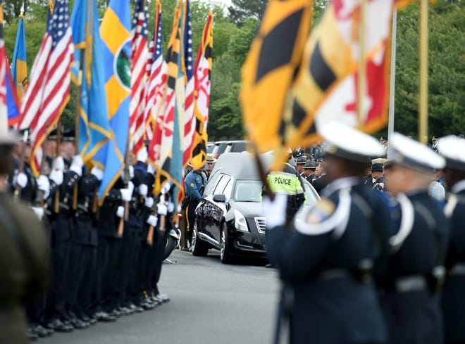 Cpl. Keith Heacook is placed into a hearse after the funeral services Monday, May 10, 2021, at Emmanuel Wesleyan Church in Salisbury, Maryland.
