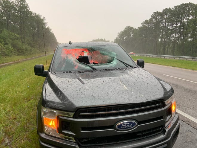 A Ford pickup truck after a chunk of highway pavement hurled into the windshield following a lightning strike on I-10.