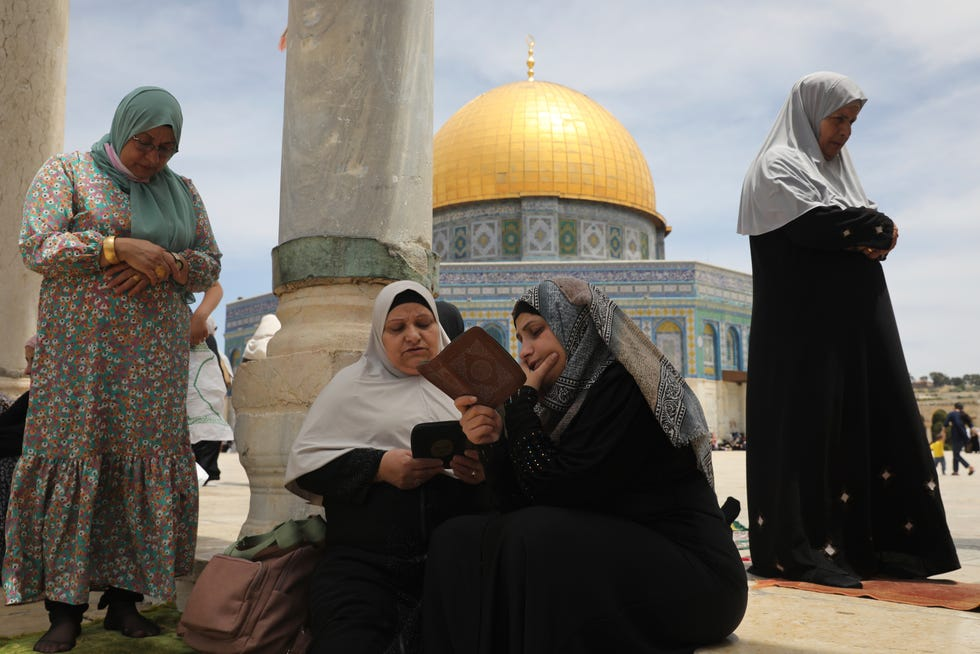 Palestinian women take part in the last Friday prayers of the Muslim holy month of Ramadan at the Dome of the Rock Mosque on May 7, 2021.