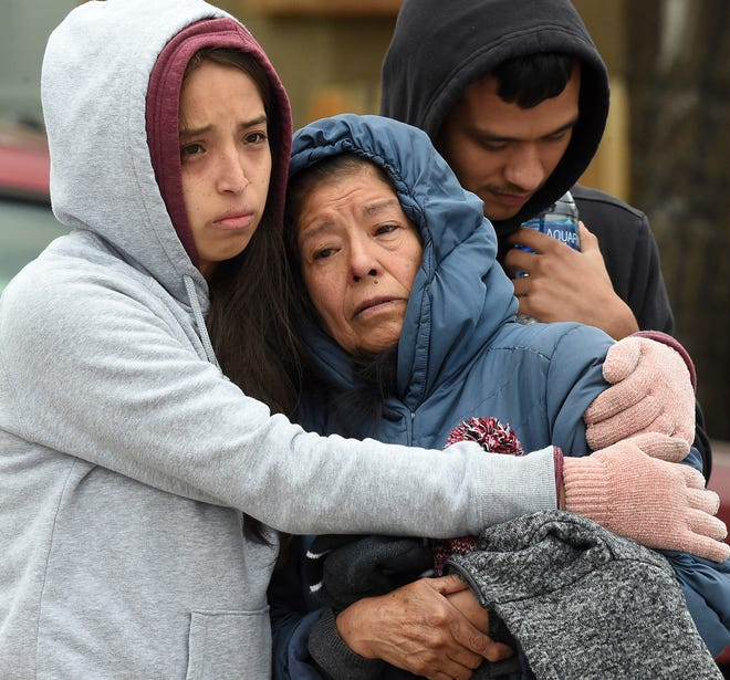 Family members mourn at the scene where their loved ones were killed early Sunday, May 9, 2021, in Colorado Springs, Colo.