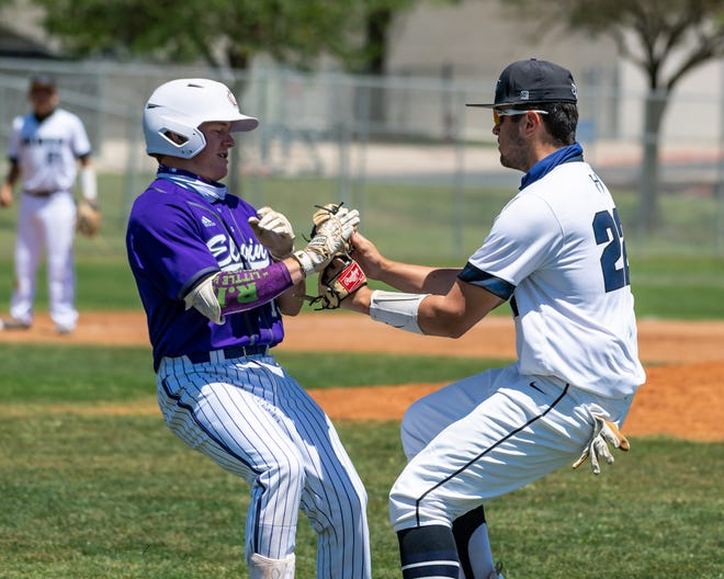 Hendrickson first baseman Jordan Malott, right,  puts the tag on Keaton Grady of Elgin in a game earlier this season. Both District 18-5A teams won their first-round playoff series to advance to the second round of the UIL state playoffs.