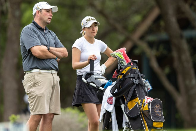 Amarillo head coach Skyler Walden, left, speak with Alexis Escobedo before she hits from the 14th tee box during round 1 of the UIL Class 5A girls golf tournament in Georgetown, Monday, May 10, 2021.