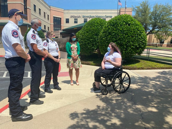 Tiana Richardson, right, is reunited with the first responders who helped save her life following a horrific wreck last year. From left are Williamson County EMS first responders Parker Harman, Cmdr. Kevin Krienke and Megan Foster, and St. David's Round Rock Medical Center's Elena Bisasatti.