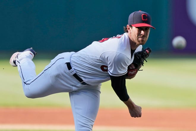 Cleveland starting pitcher Shane Bieber delivers in the first inning of a baseball game against the Chicago Cubs, Tuesday, May 11, 2021, in Cleveland. (AP Photo/Tony Dejak)
