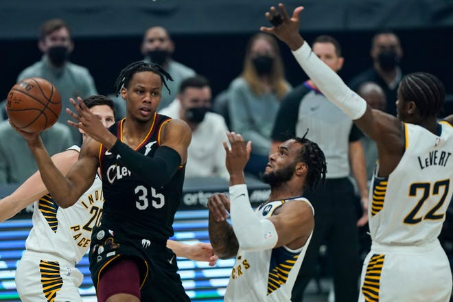 Rookie guard Isaac Okoro (35) has been a bright spot as a disappointing, injury-filled season winds down for the Cavaliers. [Tony Dejak/Associated Press]