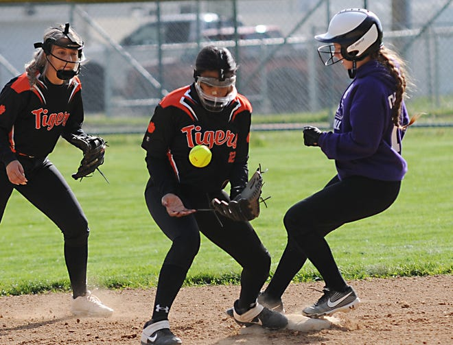 Sebring McKinley's Kalyla Caliguire advances safely to second base during a Division IV tournament game against Wellsville Monday.