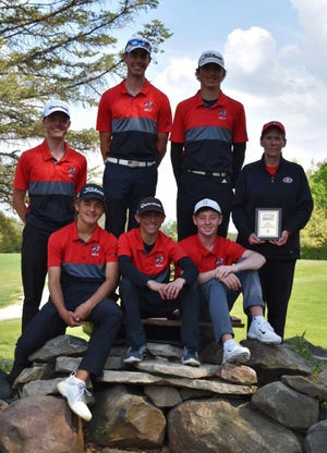 Members of the Gilbert boys' golf team pose with head coach Holly Lester after winning the Raccoon River Conference boys' golf meet by 29 strokes Monday at the Lakeview Country Club in Winterset. Lester is holding her plaque for being named the 2021 RRC boys' golf Coach of the Year.