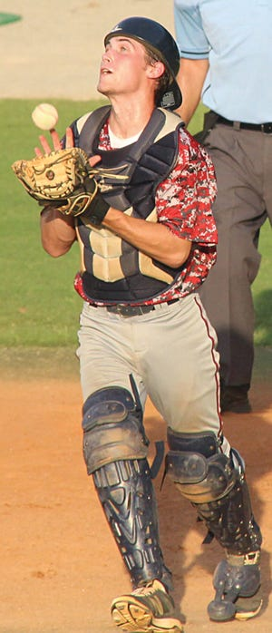 A Doenges Ford Indians' catcher records an out during the 2016 season.