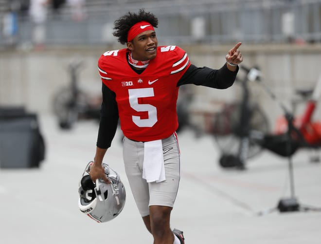 Ohio State wide receiver Garrett Wilson, here leaving the field after the spring game April 17, has caught 73 passes for 1,155 yards and 11 touchdowns in two seasons.