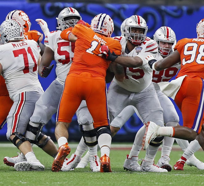 Matt Jones (55), seen here blocking in Ohio State's College Football Playoff semifinal win last season over Clemson, has played well since filling in for the injured Thayer Munford.