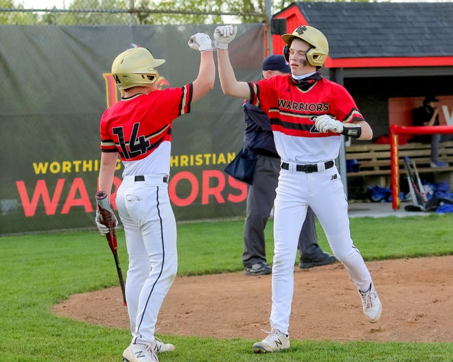 Connor Hendrickson (#14) and Sam Blank (#21) go for a fist bump after Blank scored at the Worthington Christian Athletic Complex on April 14, 2021.