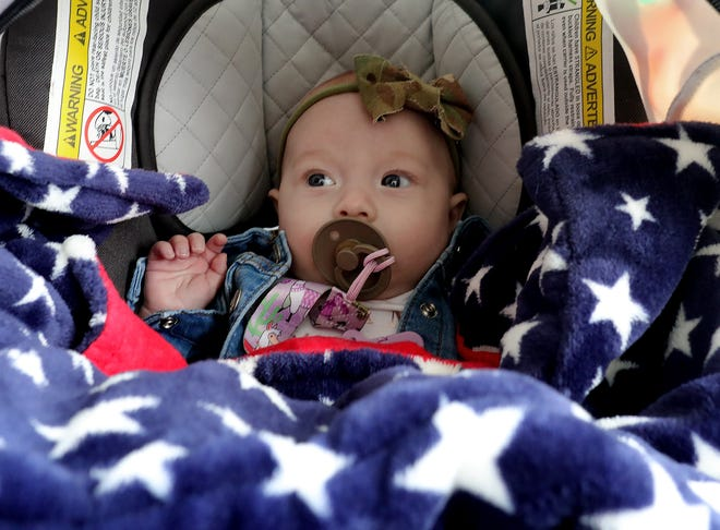 Everly Dannemiller, who is less than 4 months old, was at Fortress Obetz Tuesday to welcome her dad, Sgt. 1st Class Andrew Dannemiller, and about 100 other Ohio National Guard soldiers back home after a nearly yearlong overseas deployment. It was the first time her father saw her in person.